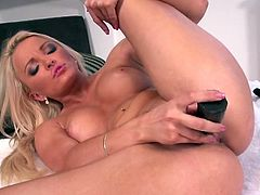 Blonde eurobabe fingers and toys her shaved pussy with her cockring vibrator and black dildo she then goes for anal by dildoing her ass