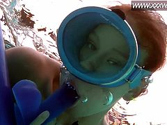 Underwater masturbation and dildo fucking with a small tits cutie