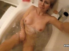 Brett Rossi takes you with her while she slides into more than just a warm bubble bath. She teases with her big booty then masturbates under water!