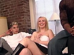Black man sitting next to her is showing her his big king dong, getting her so aroused, she tells him and his friend, that shell give one of them a blowjob if the other will slide his cock into her shaved pussy and fuck her for an orgasm and then, shell let them give her two facial cumshots.