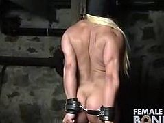Naked Female Bodybuilder Struggles in Restraints