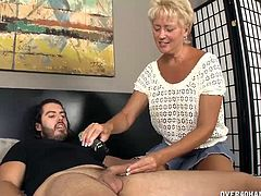 This guy has been using a liquid for hair and he realizes it is his aunts lube. But what does she use lube for hes wondering. Now his aunt is going to teach him what this lube is used for. She jerks his dick making him explode with milk.
