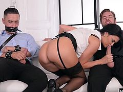 See her dress up in hot as fuck lingerie while her ass and pussy get fucked by a stranger. She is not more than three feet away from her husband as he watches while tied up with his mouth taped and his cock out. In the end he get in on the action as he fucks his wifes pussy for a sloppy second.