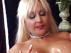 Sexy blonde babes share a double ended dildo