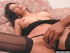 Sexy brunette Latina, Livia, eating some sexy lingerie and thighhigh stockings