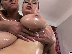 They bust out the massage oil. Nothing makes tits better to play with than some nice slick lube. Watch them get oiled up and play with their tits and pussies in this hot one on one scene.