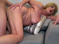 This old blonde is getting plowed by a big dick really hard in her old and withered pussy. She hasn't had sex in years, so she is very happy. They kiss and the old lady takes his big cock hard from behind.