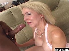 After seeing her big, natural hooters hanging there while she gives this guys fat, black dick a blowjob, before she gets to ride on his pole and collect his facial cumshot, in this hardcore, interracial, one on one.