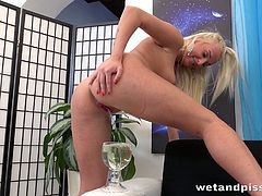 Kinky blonde Daisy Lee pisses in her shorts and masturbates pussy