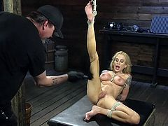 The master shoved a big pole up Sarah's cunt and stretched it out so wide. The tighter the rope gets, the more turned on she becomes. Soon she is ready to have her cunt whipped so hard until she orgasms and cums all over the place.