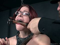 Tied up chubby chick Kel Bowie gets her muff punished in the dark room