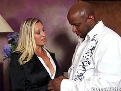 Milf Devon Lee is going from door to door actually looking for free cocks. Came into a black man's house and entices him with her sexy big tits. Start sucking hig big black cock. Mounting her pussy over it for fucking and gets a chest cumshot.