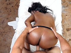 Ebony babe with bubbled ass Daya Knight gives a titjob before a steamy cock riding