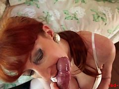 Mature slutty redhead dressed in her riding gear fucks her tight twat with her crop. Her pussy gets so wet she can't resist sucking the cameraman's hard throbbing cock.