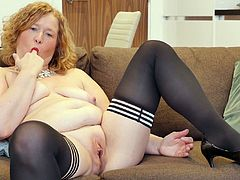 She has on her favorite black nylons and is ready for a long masturbation session. The redhead has her legs spread so wide, as she shows off her mature cunt. Would you like to bang her hard in her old twat?