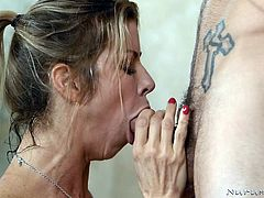 Hot milf Alexis gets pounded in the shower by her man. The blonde milf's huge boobs press up against the glass, as she gets rammed hard from behind. They are having a nice soapy fuck, when she gets on the ground to suck on his big dick.