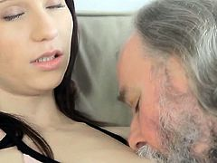 Curious young playgirl gives a oral job to an old crazy guy