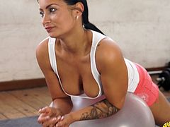 Sizzling babe Kelli Smith does exercises and shows off her tasty looking boobies