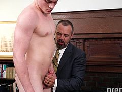 Elder Edwards has been summoned to President Ballard's office. We're not sure if he's in trouble, but we are sure it's going to get hot in there. Up on the desk goes Elder Edwards and the older man's lust rises (along with his cock!).