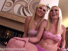 Two identical blonde twin sisters Katie and Kelly Cameron strip completely nude and show off their amazing bodies before they drop to their knees and take turns sucking a big hard cock!
