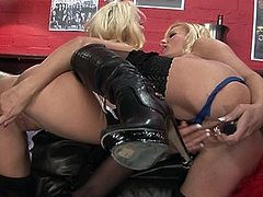 Michelle and Natasha play with one another's pussies
