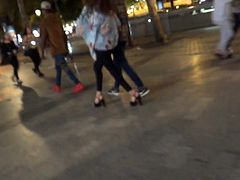 Candid hot young girl with high heels sandals