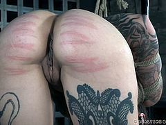 At first, it was Eden being tortured and Luna helping out. Now, Eden watches as the tatted up lovely gets her taste of pain. The hot babe with the juicy ass is bound with ropes and bent over. Her ass is swatted numerous times, making her nearly cry. What else will she be subjected to?