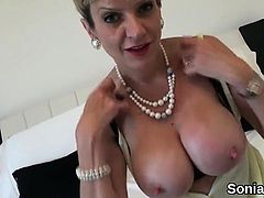 Adulterous english milf lady sonia flashes her massive hoote