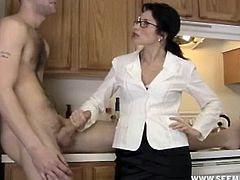 This hot mom finds a bottle of cum pills in this guys bedroom and asks what does he use them for. Guy reluctantly answers and she notices her cock bulging out. She gets curious to see if these pills really work so she puts some pills into his mouth and starts coaxing his hard cock with mouth.