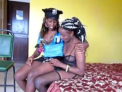 Ebony lesbians from African play dress-up in a police uniform and the other with sexy lingerie, complete with black garter-belt.