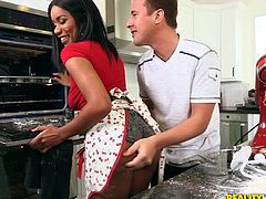 This ebony sweetheart was cooking up something delicious in the kitchen. She was covered in flour and feeling naughty. Her white boyfriend grabbed her round bum and pulled out his cock. She went to town sucking on his big white penis. Her natural ebony boobs are such a turn on.