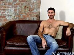 Hairy hunk Craig Daniel stroking his huge uncut cock solo