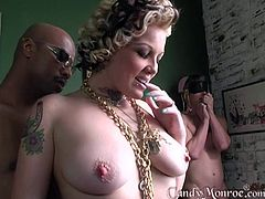 Tattooed chick Candy Monroe fucks with a black guy while she moans