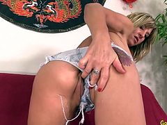 Horny mature woman plays with her tits She teases her pussy and asshole with her fingers She fucks her pussy and asshole with a dildo She continues wanking with a vibrator