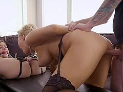 There is some really kinky action going on in this house. The short-haired sexy blonde has tied up her lover and gagged her mouth. She eats her clamped pussy, while her male lover rams his big cock deep in her cunt from behind.