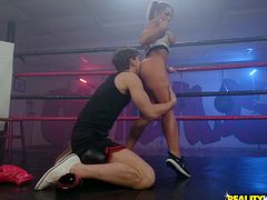 Cali is in the ring, training faithfully as she does. Markus is her sparring partner, although their workout is a bit unusual. It is a sexy hybrid of fucking and fighting. The sweaty, oily hottie gets tongued in both her holes, before hitting her knees for some oral training.
