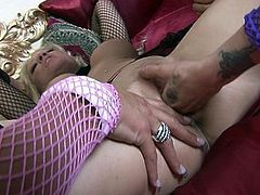 Busty beauties oil up one another's titties