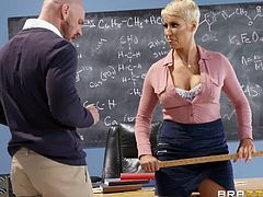 Open the door of this school class and you will find the answer to many questions. While students have lunch in the school cafeteria, teachers do not waste their time in vain. Smoking hot busty teacher Ryan Keely, gets her wet pussy stuffed with a huge cock.