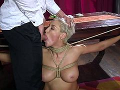 She needs to open her mouth as wide as she possibly can, to let his huge and juicy dick enter inside. The busty milf really enjoys these brutal bdsm games and gladly agrees to do everything, to make her horny lover happy and to get her hot body covered in his sticky semen...