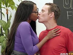 This hot ebony milf teacher wants a big black cock. She wraps her lips around that meaty dick and sucks him off in the classroom. Watch her stroke the shaft and play with his big nutsack. He is cumming so hard now.