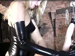 Latex-Dom works Slave to cum