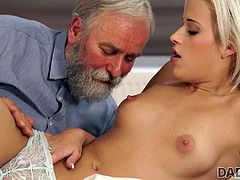 Thanks to his vast experience, this gray-haired old man with a beard knows what to do while his dick is not hard enough... He fingers and licks the blonde babe's juicy pussy, and later, she sucks his cock. Have fun and enjoy the spicy bits of scandal!
