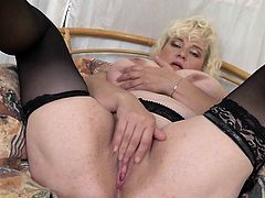 Take your time and enjoy this hot video with Agness. Her huge saggy tits will instantly make your dick rock hard. The busty mature will rub her wet pussy just for you! Pull your cock out of your pants and have fun!