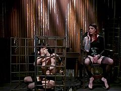Violet Monroe is immobilized and placed in a large metal cage, which means that she will have to fulfill all the whims of her extraordinary mistress. Chelsea Marie is a pretty busty babe but... with a big dick and her caged sex slave has no choice, but to suck the tranny's dick
