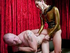 Kendra Sinclaire in her golden latex costume will drive evey guy crazy, especially those of them who like women with big dicks... This hot tranny was born to dominate and her hard cock will easily find her way into every guy's tight asshole.
