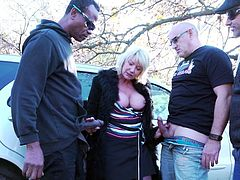 This busty mature knows how to make fast money and have fun. See and maybe you should also try this method. The slutty blonde sucks dicks and gets fucked on the side of the road... Hot stuff! Join and enjoy!