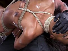 The moment a huge dildo entered the ebony's babe tight pussy, she dangled in the middle of the room, tied with ropes. It was a very sophisticated punishment, so join and enjoy rough bdsm session. Have fun!