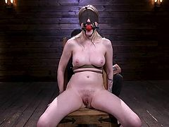 Violet October doesn't know what will happen next moment, as her eyes are covered with a dense mask and she doesn't see what other punishments the master is preparing for her. He has two huge sticks in his hands and he intends to stick them in her wet pussy and tight asshole...