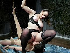 Chanel uses her huge and long dildo to penetrate the submissive slave's tight pussy, while she's bound with ropes and immobilized. But the busty mistress needs more, she sits down on the brunette babe's face and makes her to lick her wet cunt
