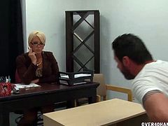 Hot teacher is in trouble as this particular student in her class has got lower grades. She summons him for a discussion and he reveals that she is the distraction. So she is going to solve this stroking his cock and titty-fucking it right in the classroom.
